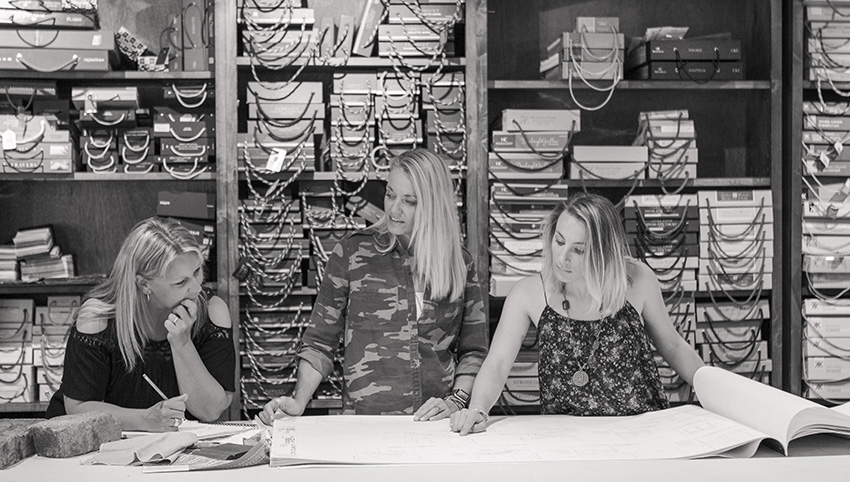 Dana Talbot, Elizabeth Robb, and Linnaea Keane working on a design project at the Elizabeth Robb Interiors studio
