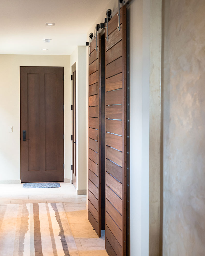 Black Bull residence hallway with sliding doors