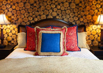 bedroom at the Bozeman Retreat designed by Elizabeth Robb Interiors with wood wallpaper detail