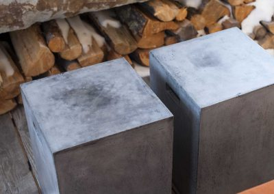 concrete stools outside at the Yellowstone Club Residence designed by Elizabeth Robb Interiors