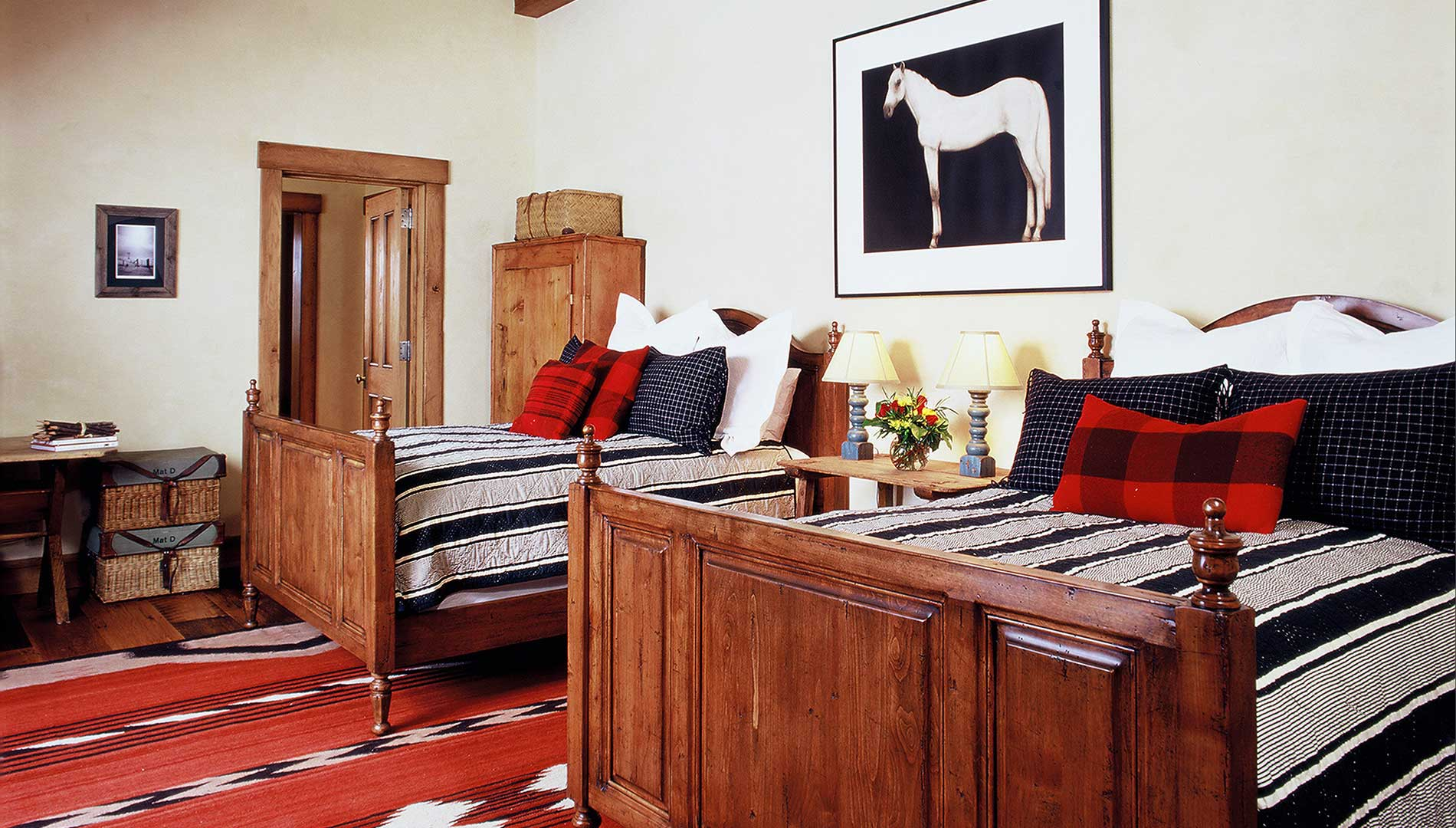 bedroom with two queen beds at the Aspen Ranch designed by Elizabeth Robb Interiors