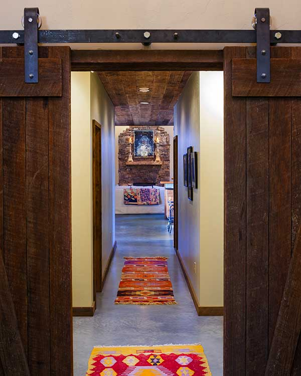 sliding doors to a hallway at the Shields River Residence designed by Elizabeth Robb Interiors