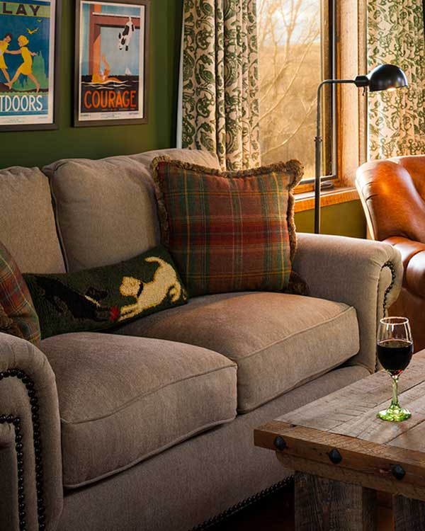 living room couch at the Shields River Residence designed by Elizabeth Robb Interiors