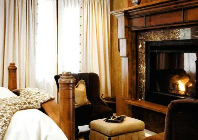 bedroom fireplace at the Yellowstone Club Residence designed by Elizabeth Robb Interiors