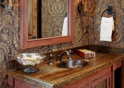 powder room at the Spanish Peaks Residence designed by Elizabeth Robb Interiors