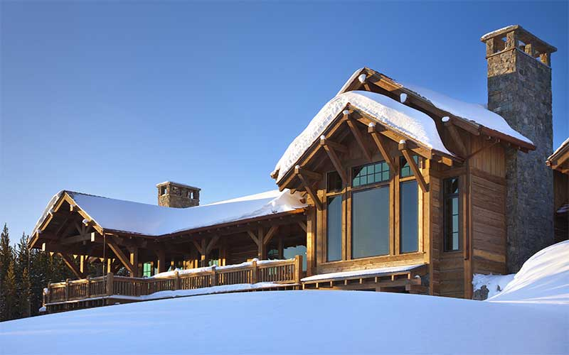 snowy exterior at the Spanish Peaks Residence designed by Elizabeth Robb Interiors