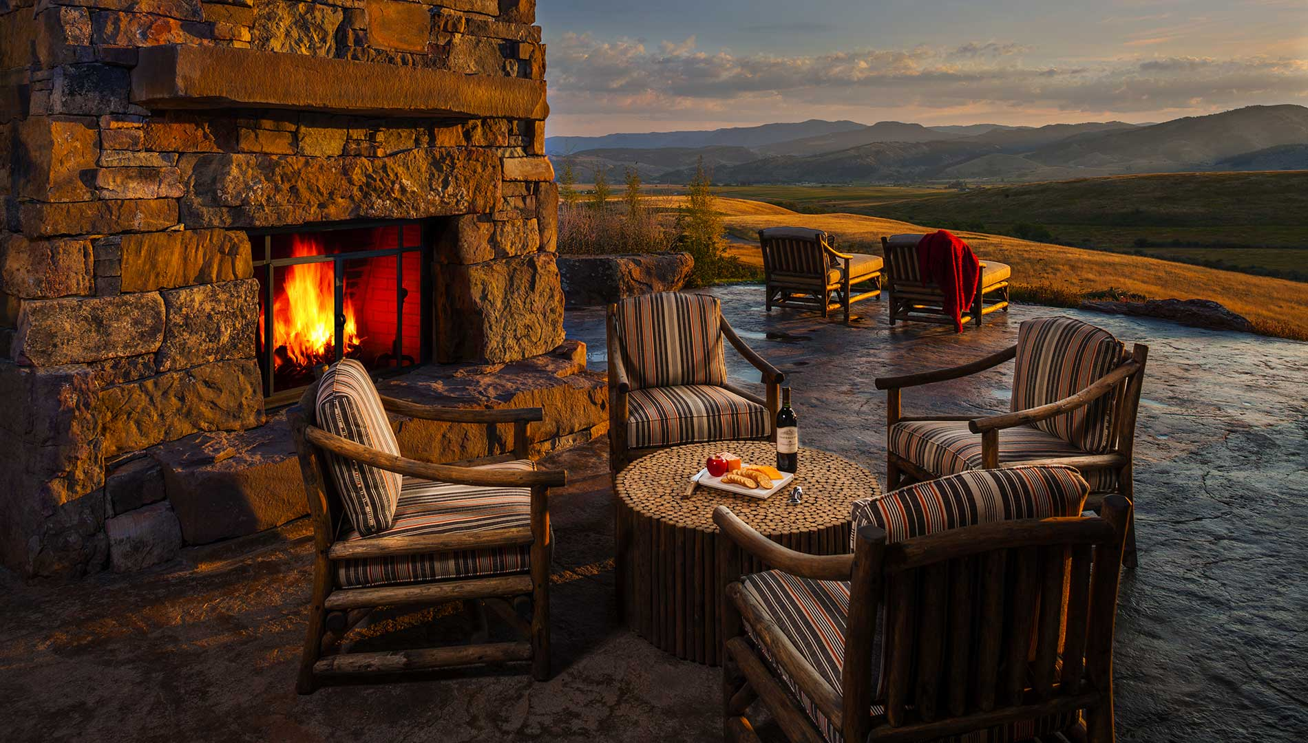 stone patio and outdoor fireplace at the Bozeman Retreat designed by Elizabeth Robb Interiors