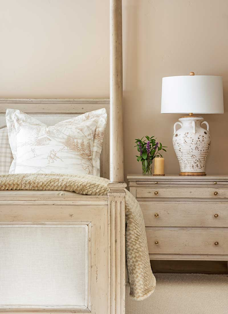 cream colored bed and nightstand of Moonlight residence designed by Elizabeth Robb Interiors
