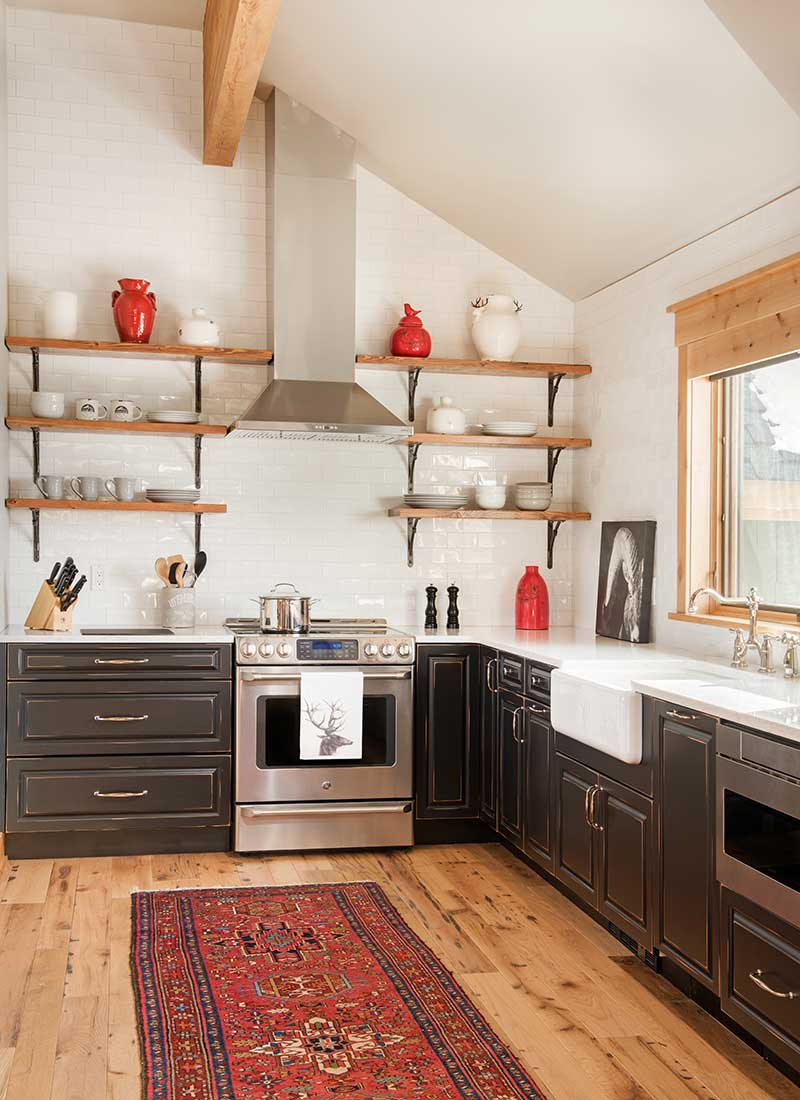 black, white, and red colored kitchen of Moonlight residence designed by Elizabeth Robb Interiors