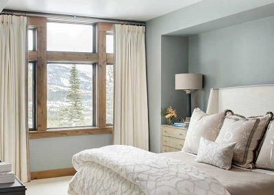 white and gray bedroom of Moonlight residence designed by Elizabeth Robb Interiors