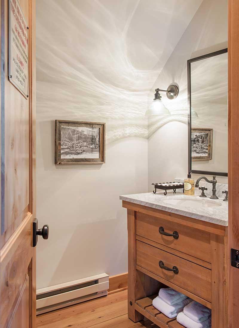 clean powder room of Moonlight residence designed by Elizabeth Robb Interiors