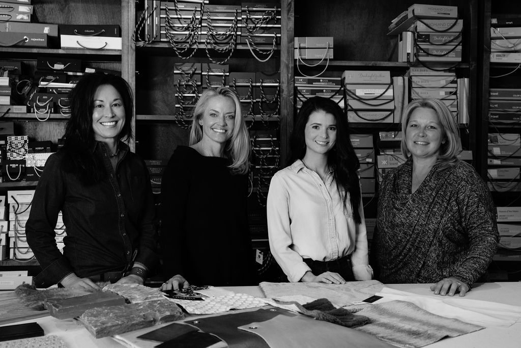 Elizabeth Robb, Dana Talbot, and Linnaea Keane working on a design project at the Elizabeth Robb Interiors studio